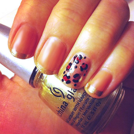 Oscar party nails featuring gold tips and leopard accent nail