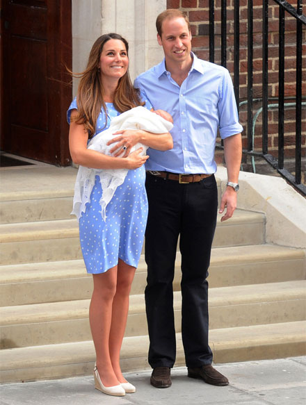Kate Middleton presents her son wearing a blue polka dot dress by Jenny Packham