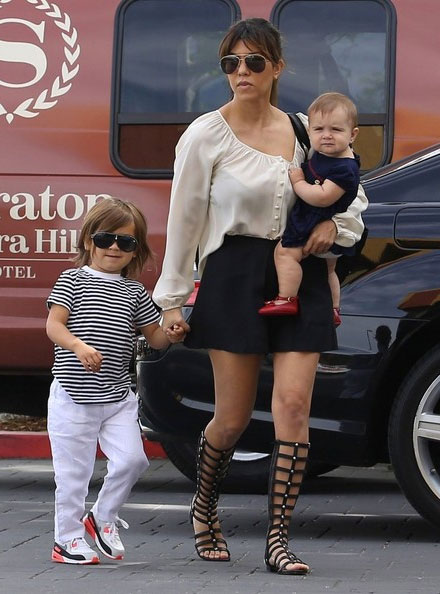 Kourtney Kardashian's gladiator sandals by Stuart Weitzman