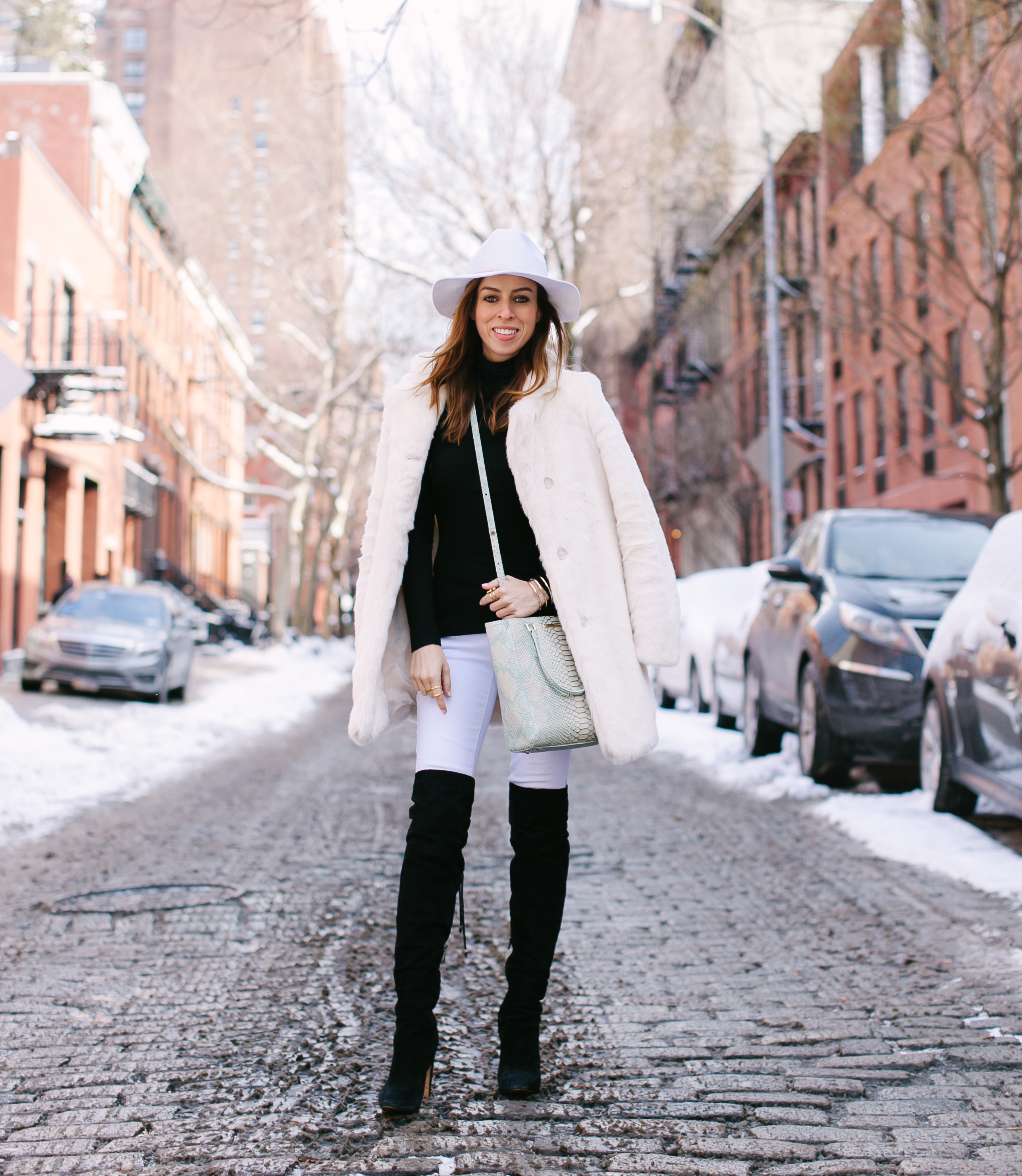 Sydne Summer's white hat, white faux fur coat and black over the knee boots