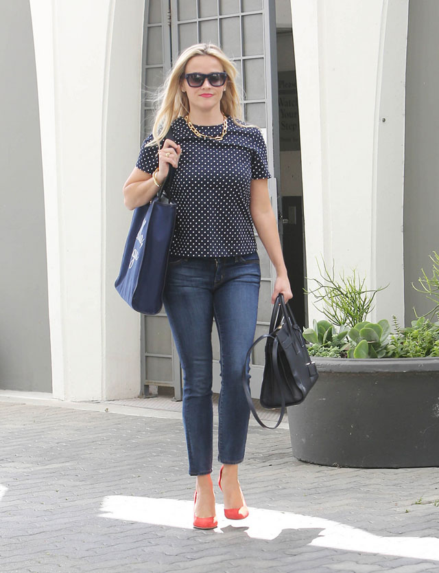 Reese Witherspoon's polka dot top, jeans, and red pumps look for less