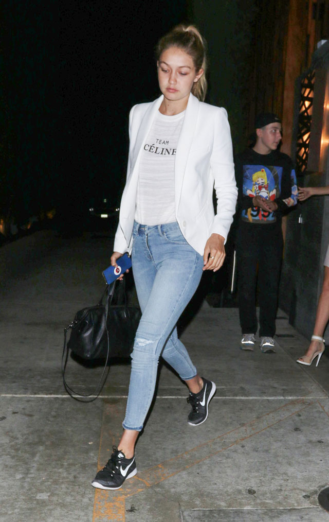 Gigi Hadid's Team Celine tee, white blazer, skinny jeans and Nike trainers look for less