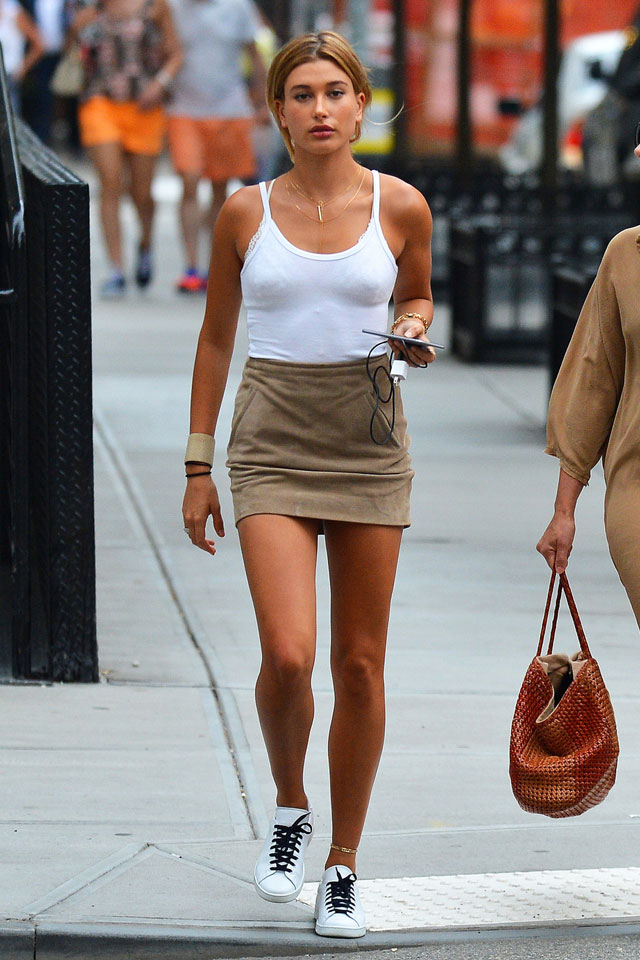 Hailey Baldwin's white tank top, tan suede skirt and white sneakers look for less