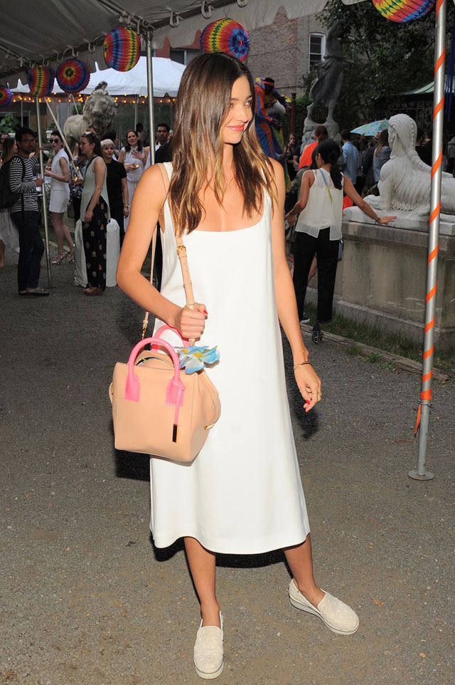 Miranda Kerr's white midi dress and nude crossbody bag