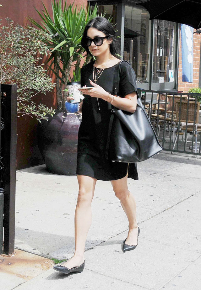 Vanessa Hudgens grabs coffee in a black shift dress, black leather oversized tote bag and Valentino Rockstud flats