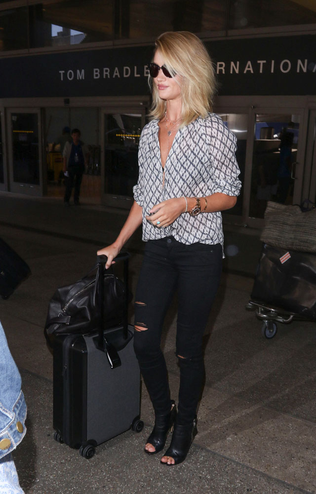 Rosie Huntington-Whiteley's print v-neck blouse and ripped skinny jeans