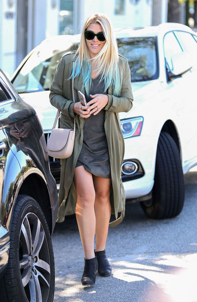 Busy Philipps' blue dipped hair, olive trench and ankle boots look for less