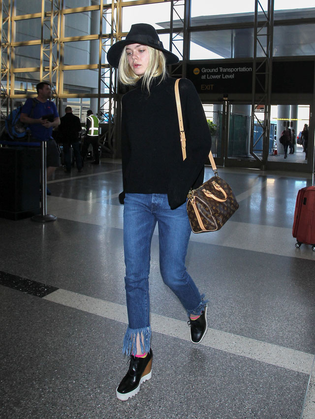Elle Fanning's fringe jeans and turtleneck sweater look for less