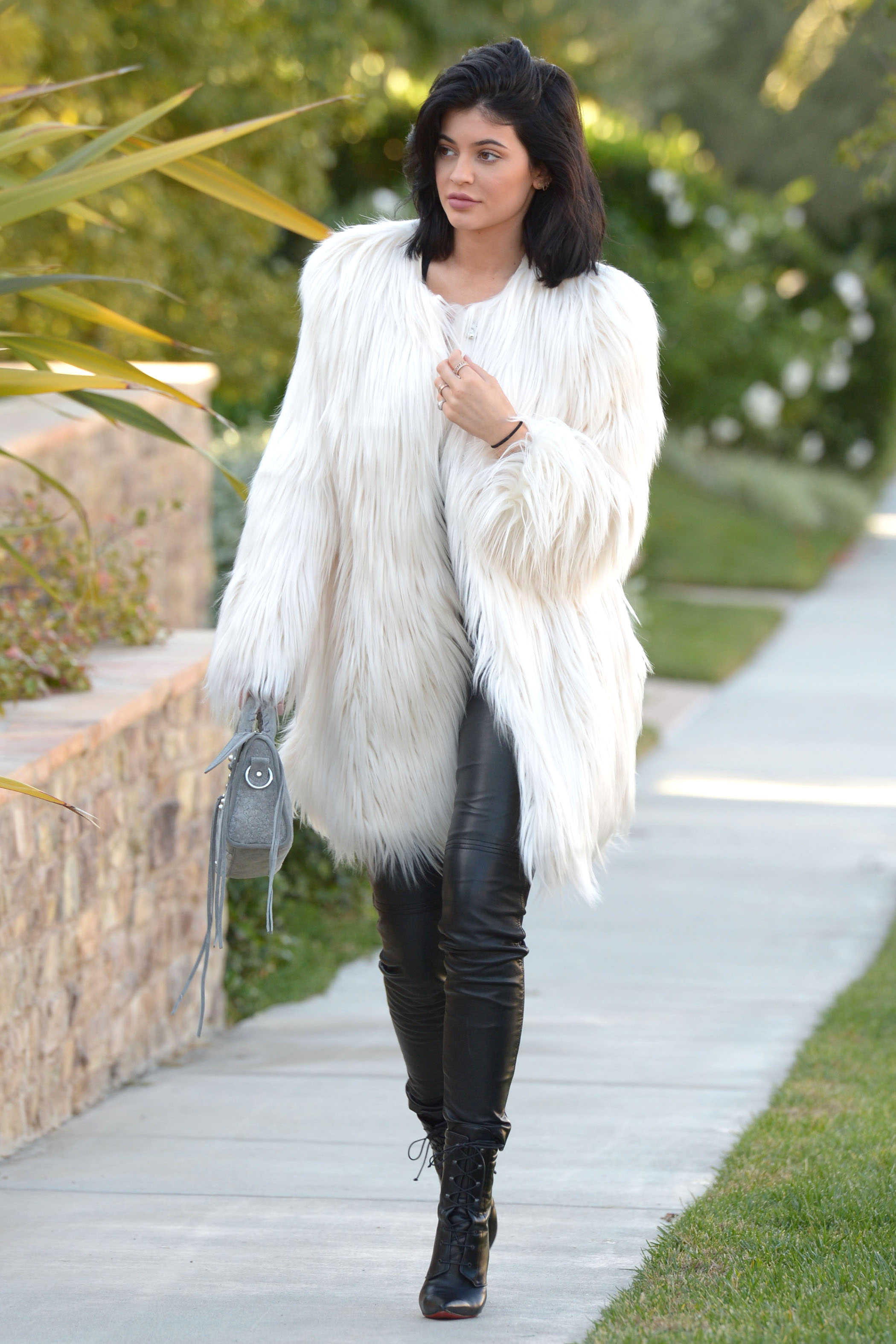 Stand Out at Holiday Parties in Kylie Jenner s White Faux Fur Coat ... f791f1ef616a