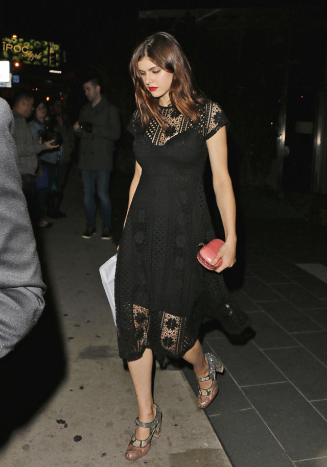 Alexandra Daddario wears a Forever 21 Floral Crochet Midi Dress while attending Photographs by Kelly Klein, at BOA Steakhouse in West Hollywood, California on January 8, 2016