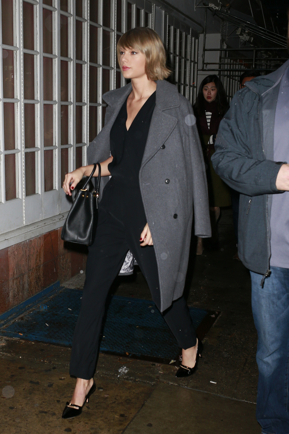 Taylor Swift Jumpsuit and Peacoat Look for Less