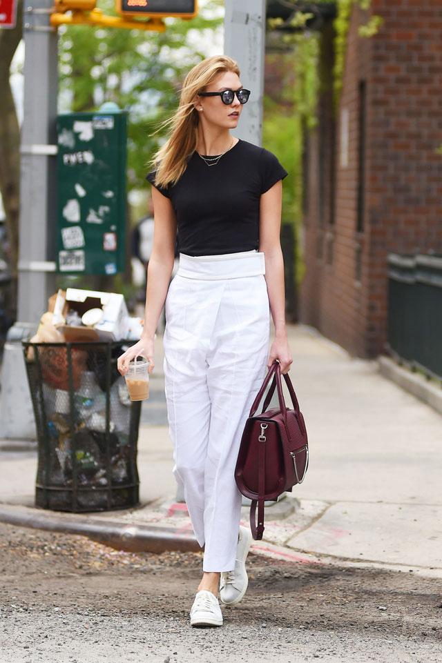 Karlie Kloss black t-shirt, white pants, white sneakers look for less