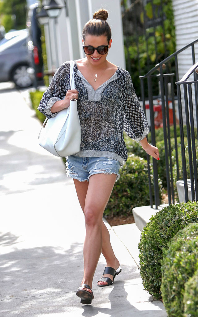 Lea Michele casual outfit idea featuring paisley boho blouse, denim cut-offs and slide sandals