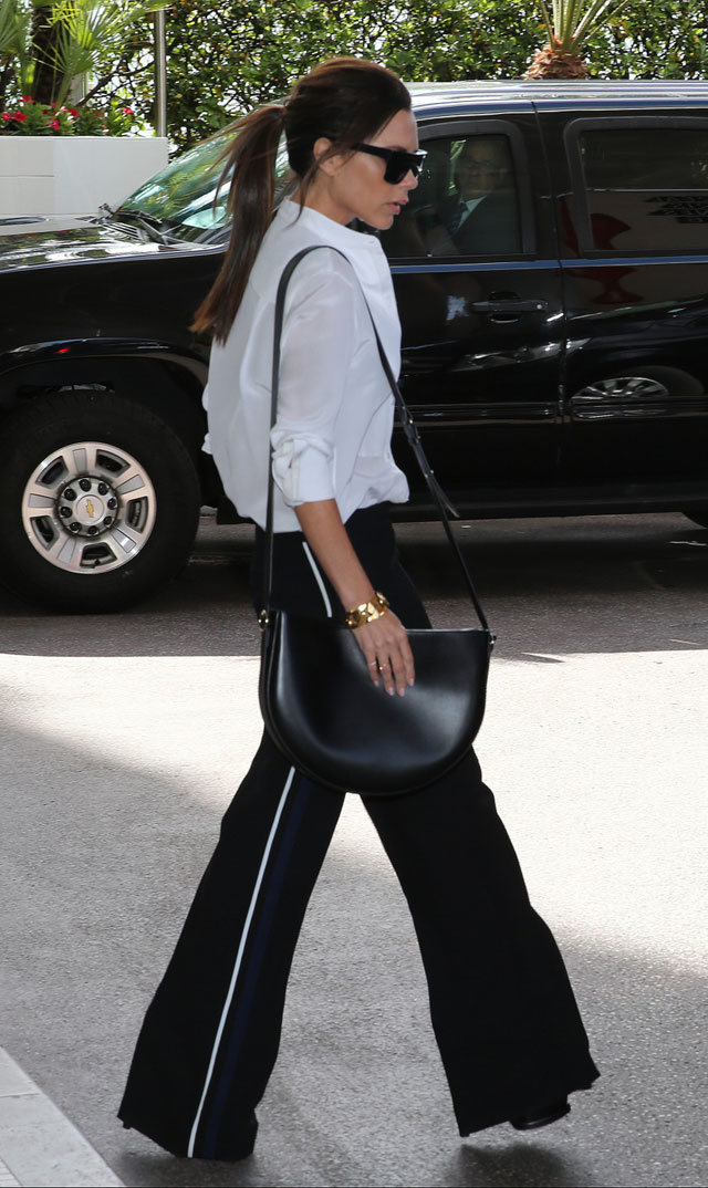 Victoria Beckham's wide leg pants and white shirt look for less