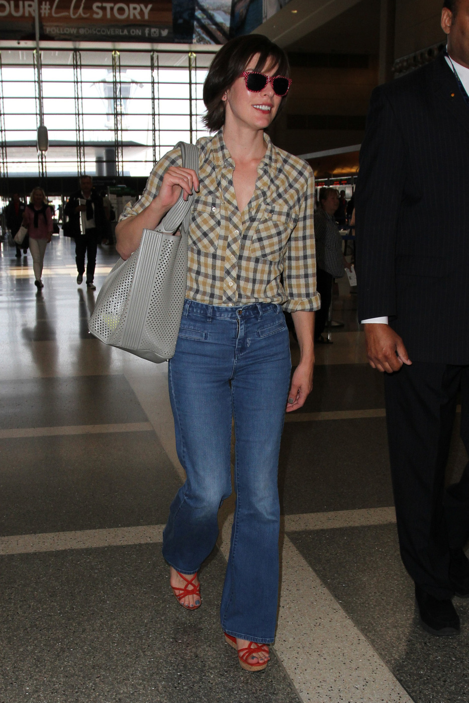 Milla Jovovich Look for Less