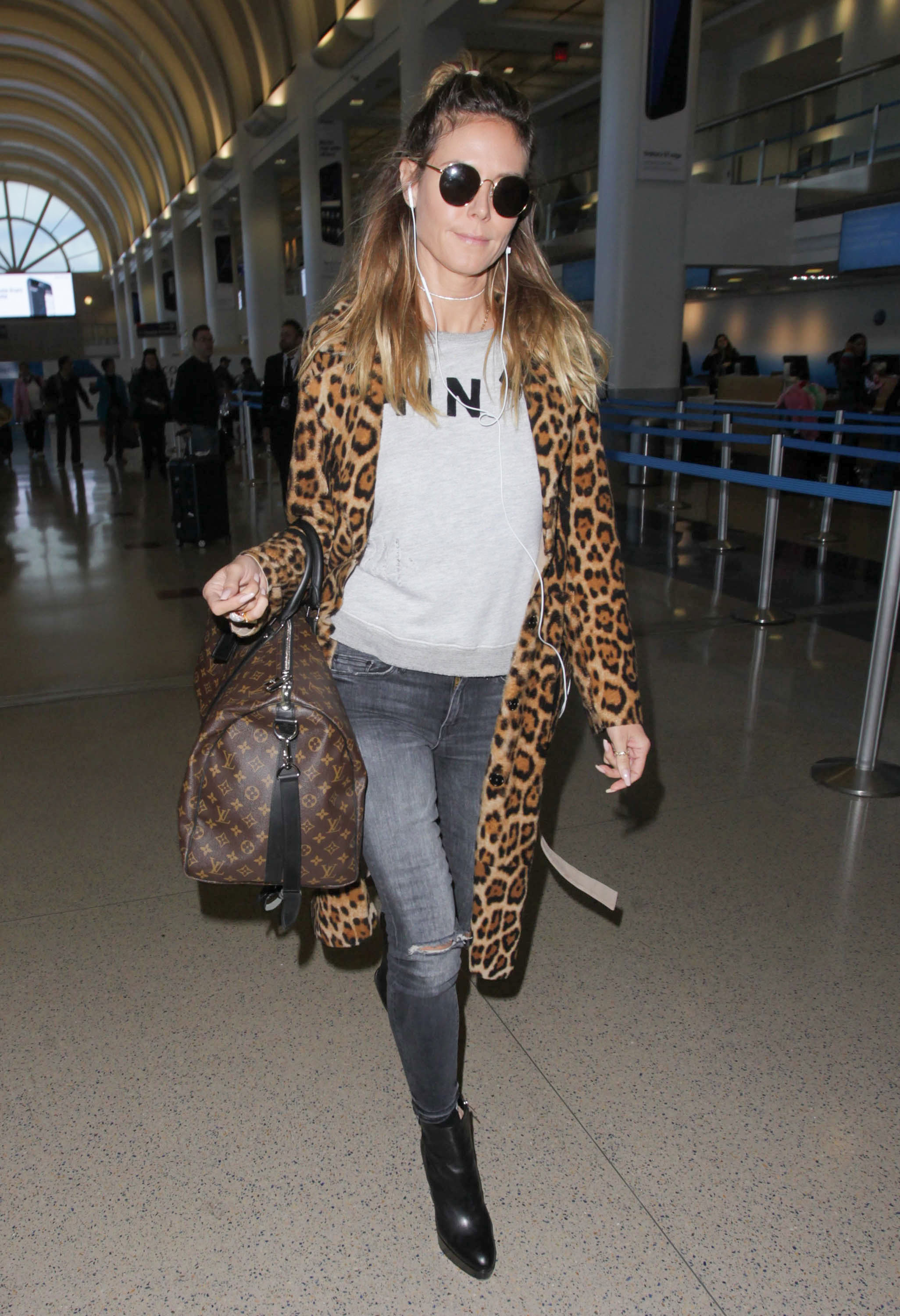 Heidi Klum's leopard coat airport style is on point.