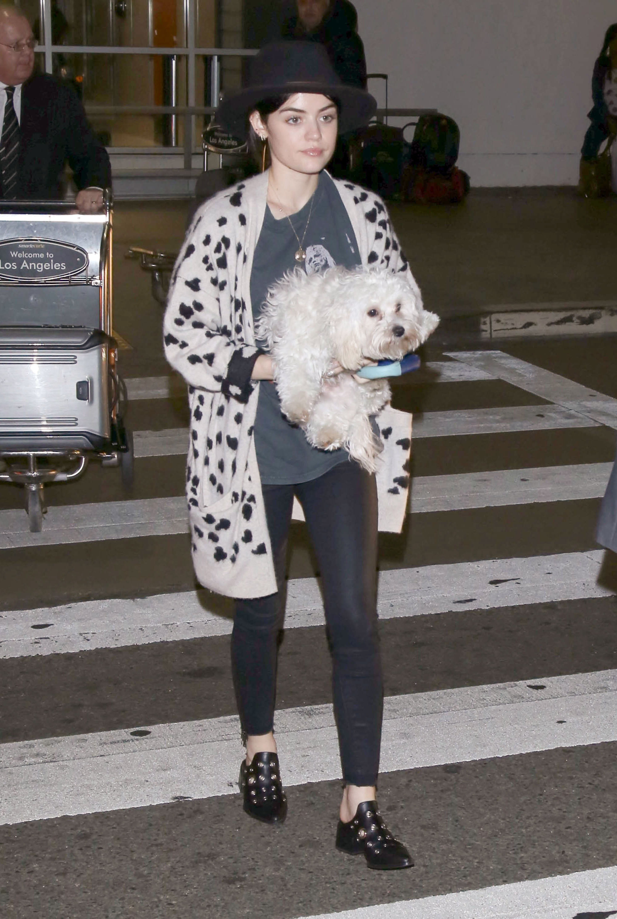Lucy Hale gives us a chic and edgy outfit idea featuring a leopard cardigan and grommet embellished mules.