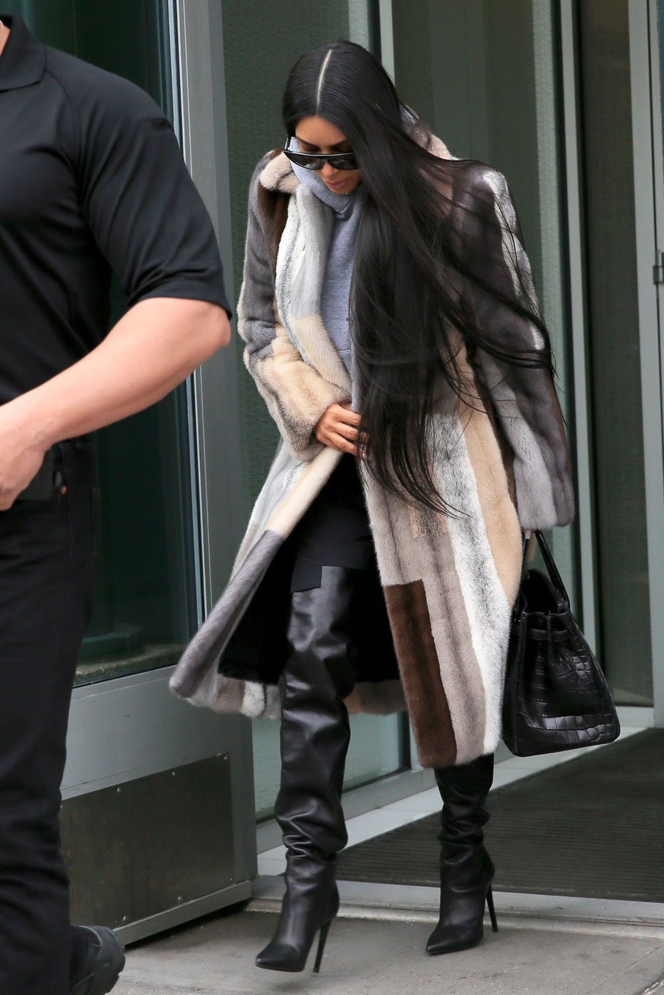 6f45ed90aa42 Kim Kardashian s Multi-Colored Fur Coat and Over-the-Knee Boots Look ...