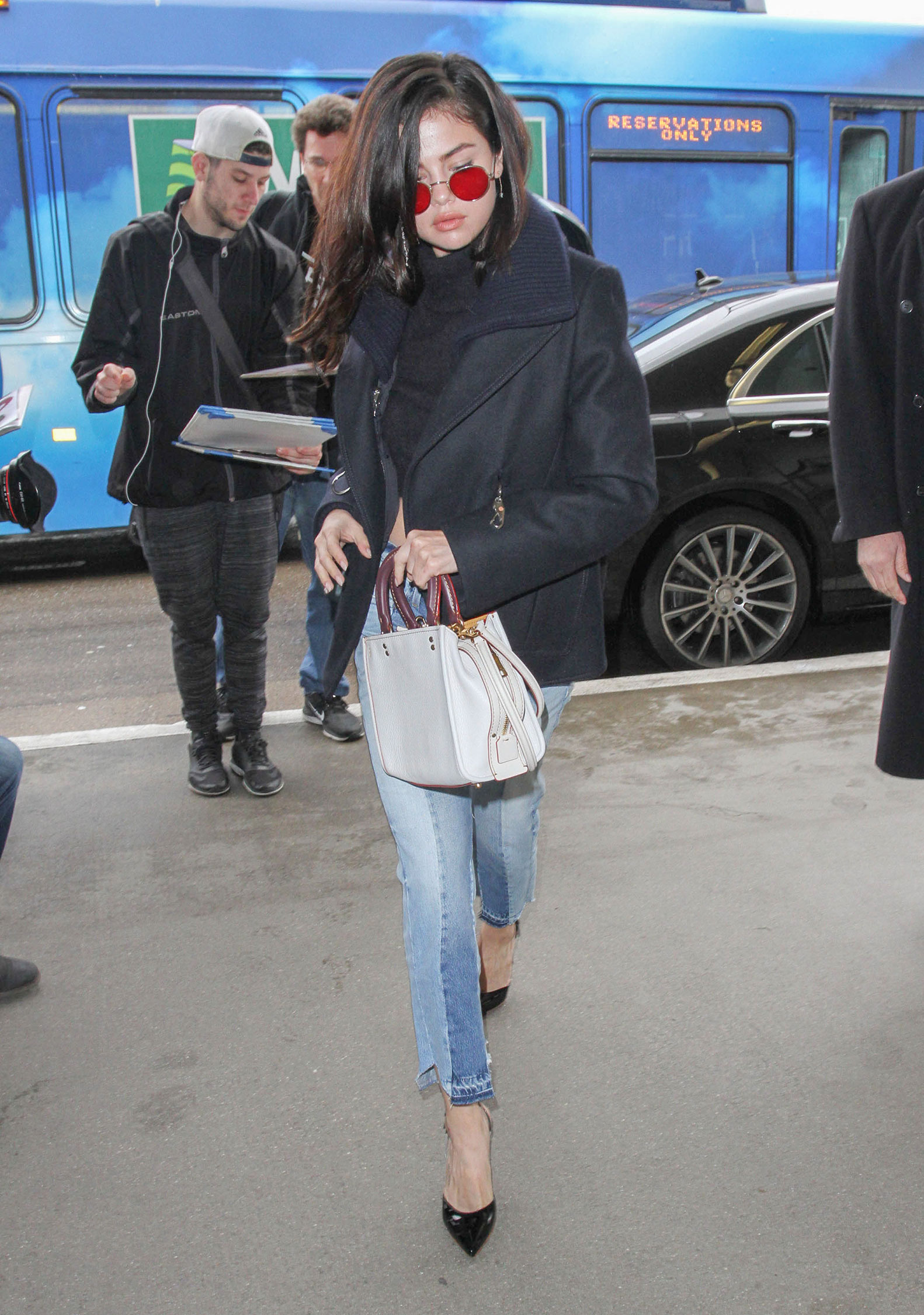 Selena Gomez is killin it her black crop turtleneck sweater, wool jacket and twist seam jeans.