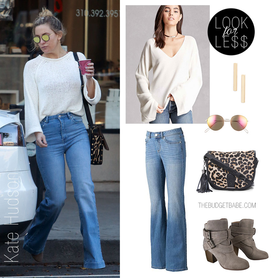 Kate Hudson styles her white bell sleeve sweater with flare leg jeans and ankle boots.