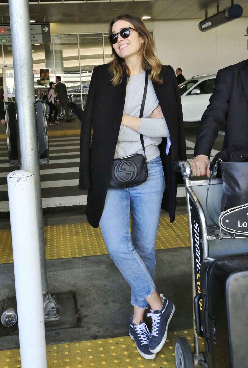 Mandy Moore accessorizes her effortlessly casual look with a Gucci 'Soho Disco' bag as she made her way through LAX.