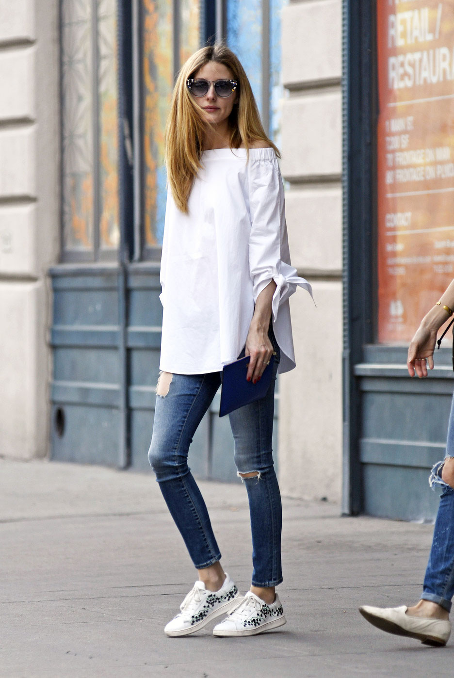 Olivia Palermo off-the-shoulder top and sneakers look for less
