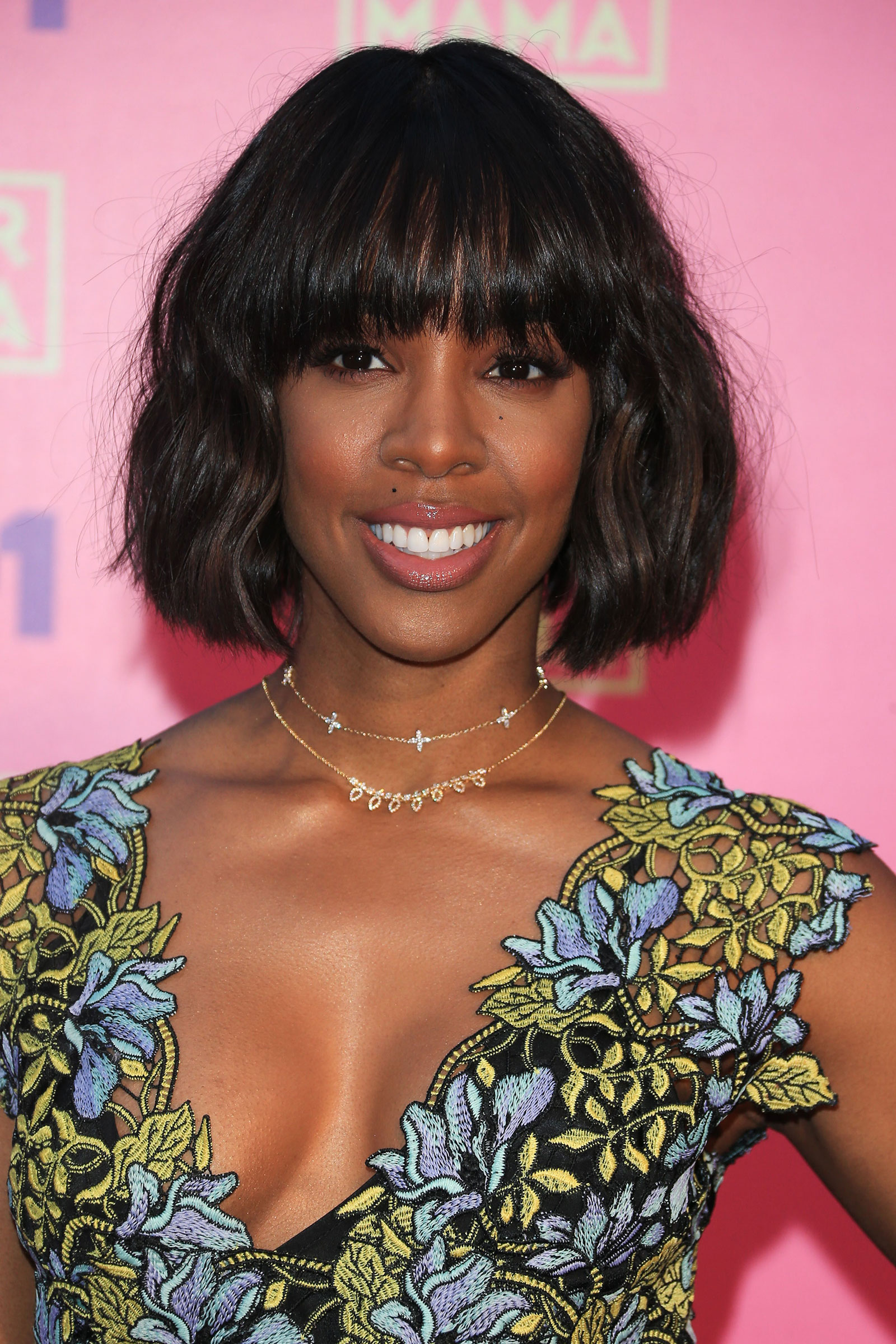 Kelly Rowland's tossled bob with bangs haircut