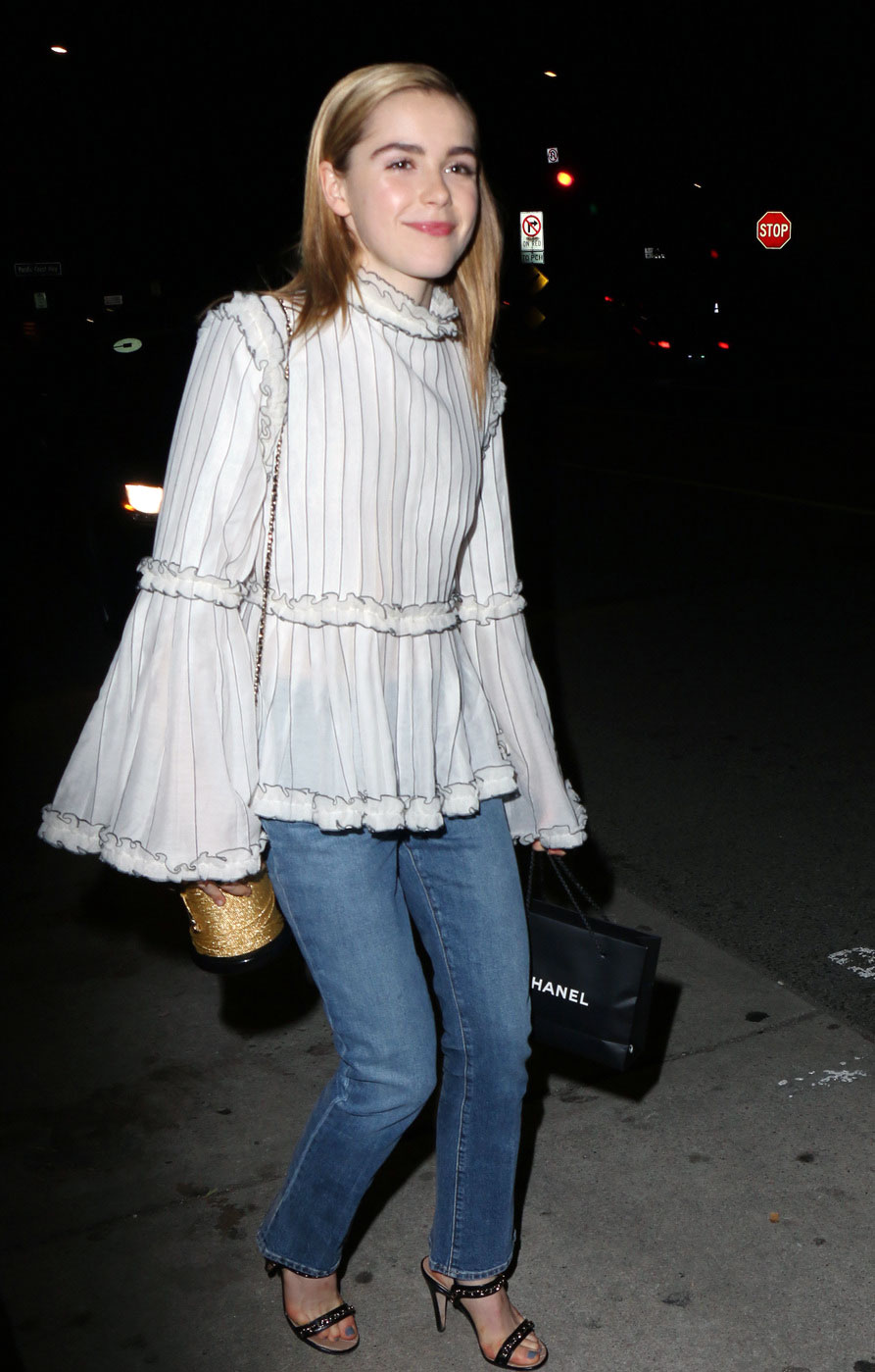 Kiernan Shipka's bell sleeve blouse and jeans look for less