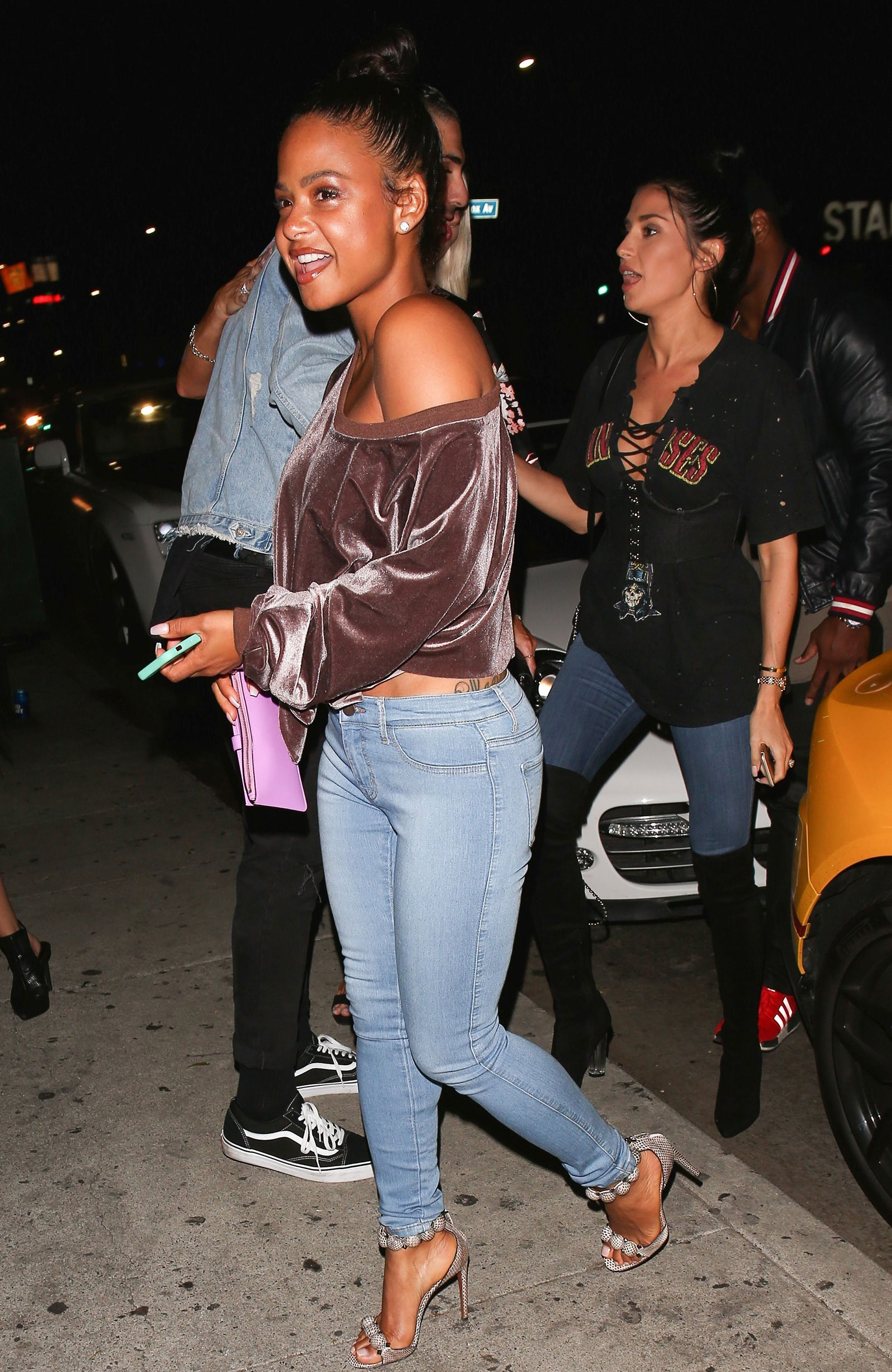 c8a66ccc62c79b Christina Milian s velvet off-the-shoulder sweatshirt and skinny jeans look  for less