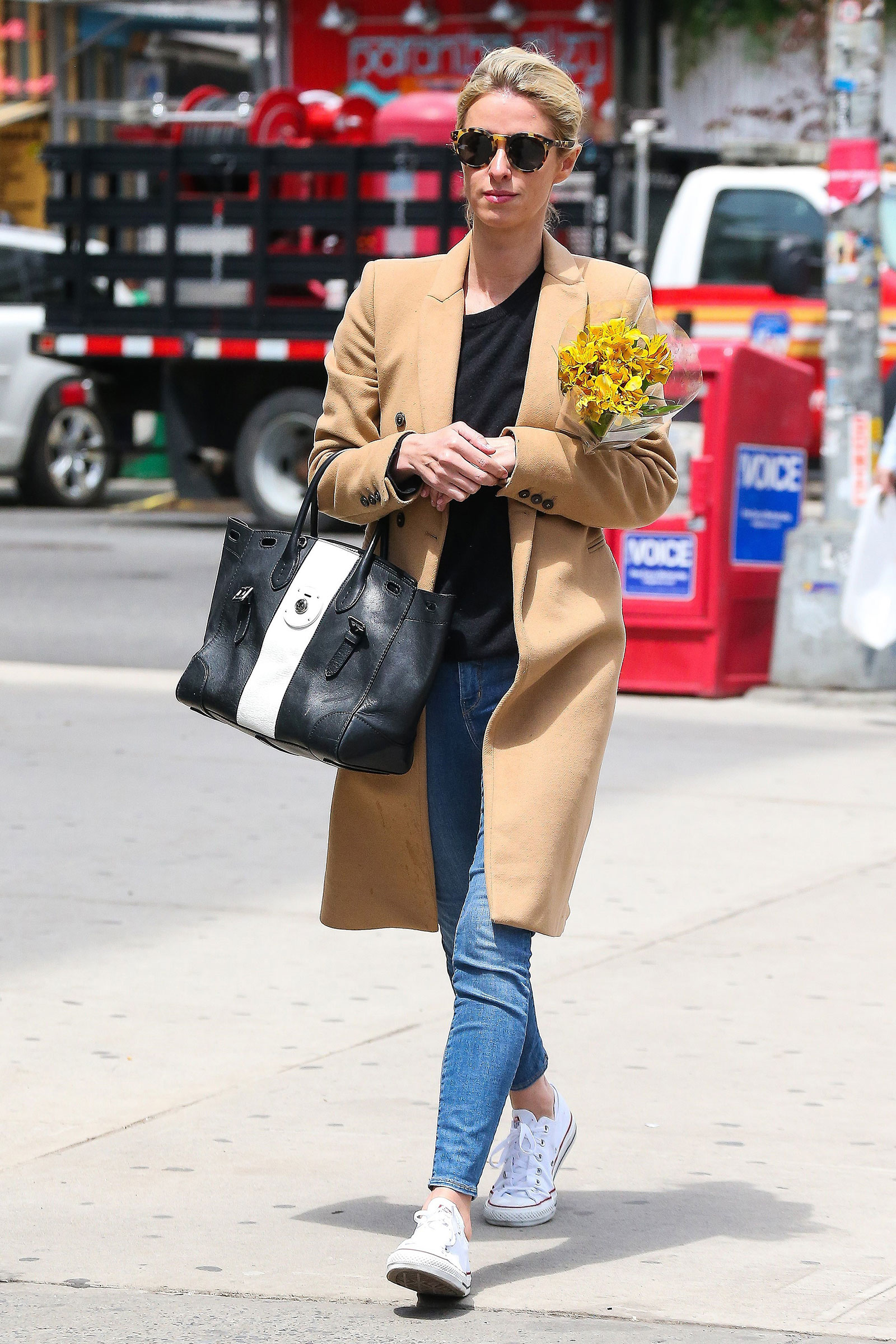 Nicky Hilton wears a camel coat and white Converse while out and about in New York City.