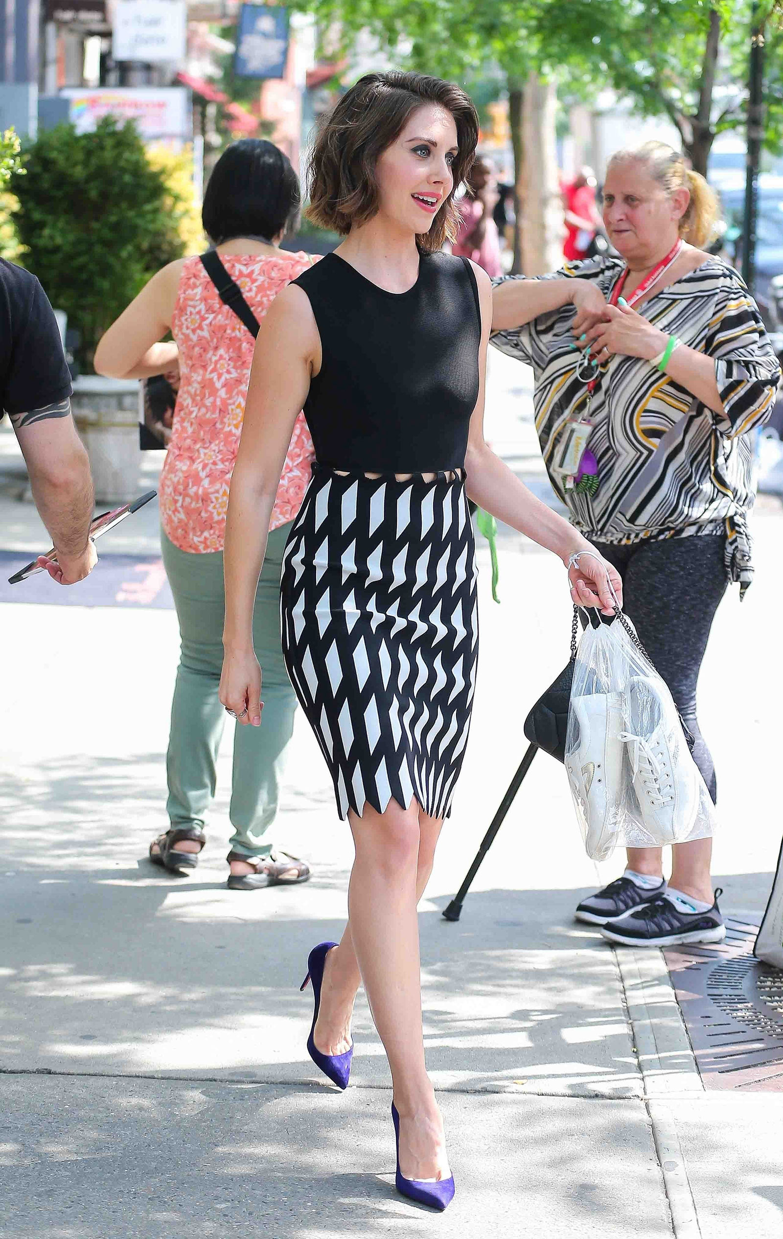 Alison Brie from Mad Men looks chic for summer in a black and white print pencil skirt.