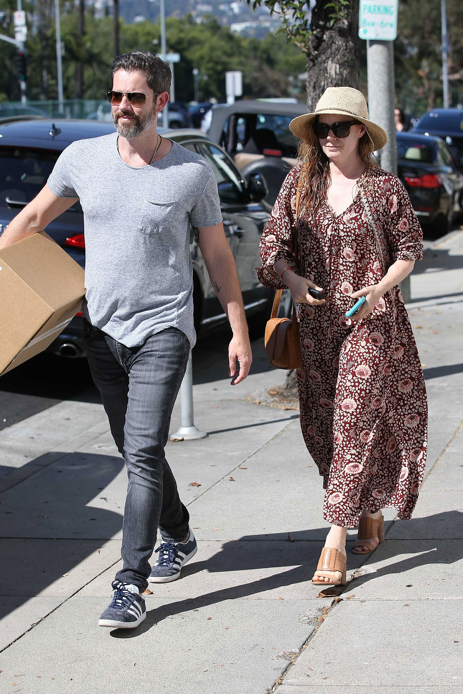 Amy Adams looks summery in a maxi dress and huarache slide sandals.