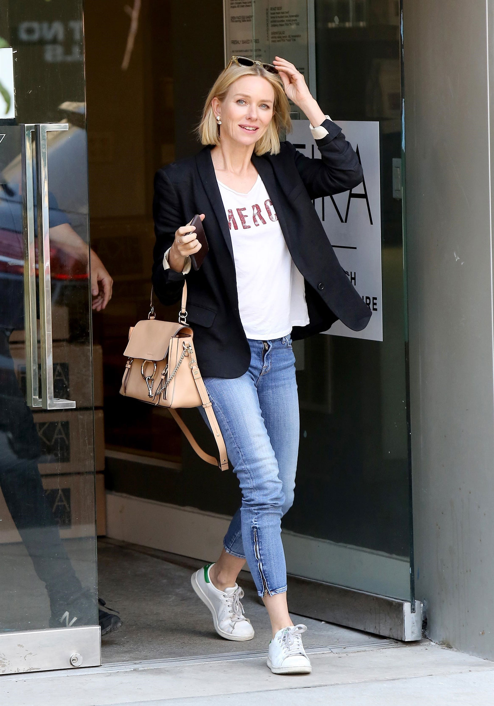 b2b4654fccad6 Naomi Watts looks cool and casual in a blazer, slogan t-shirt and Adidas