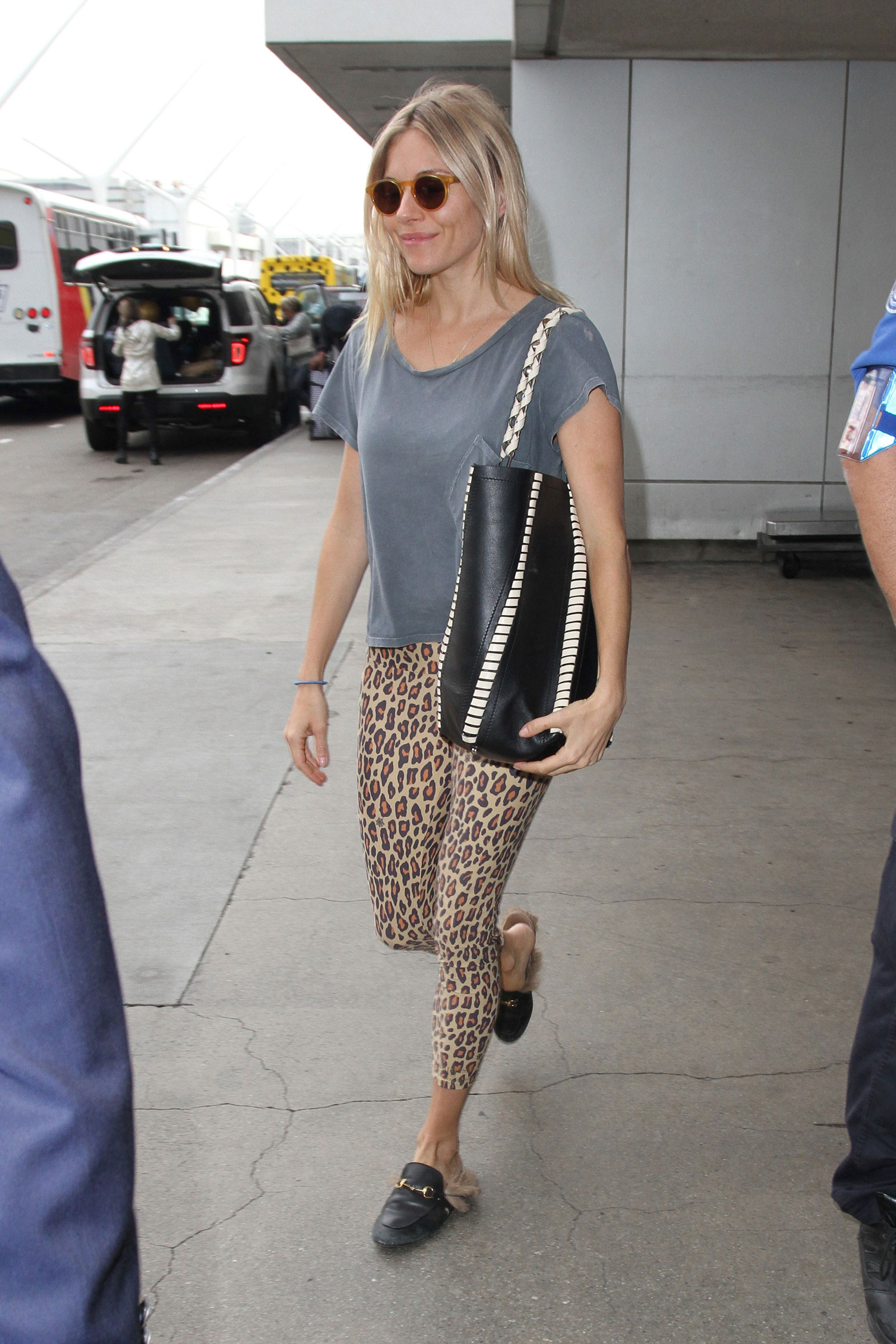 Shop Sienna Miller's leopard leggings and Gucci mules look for less.