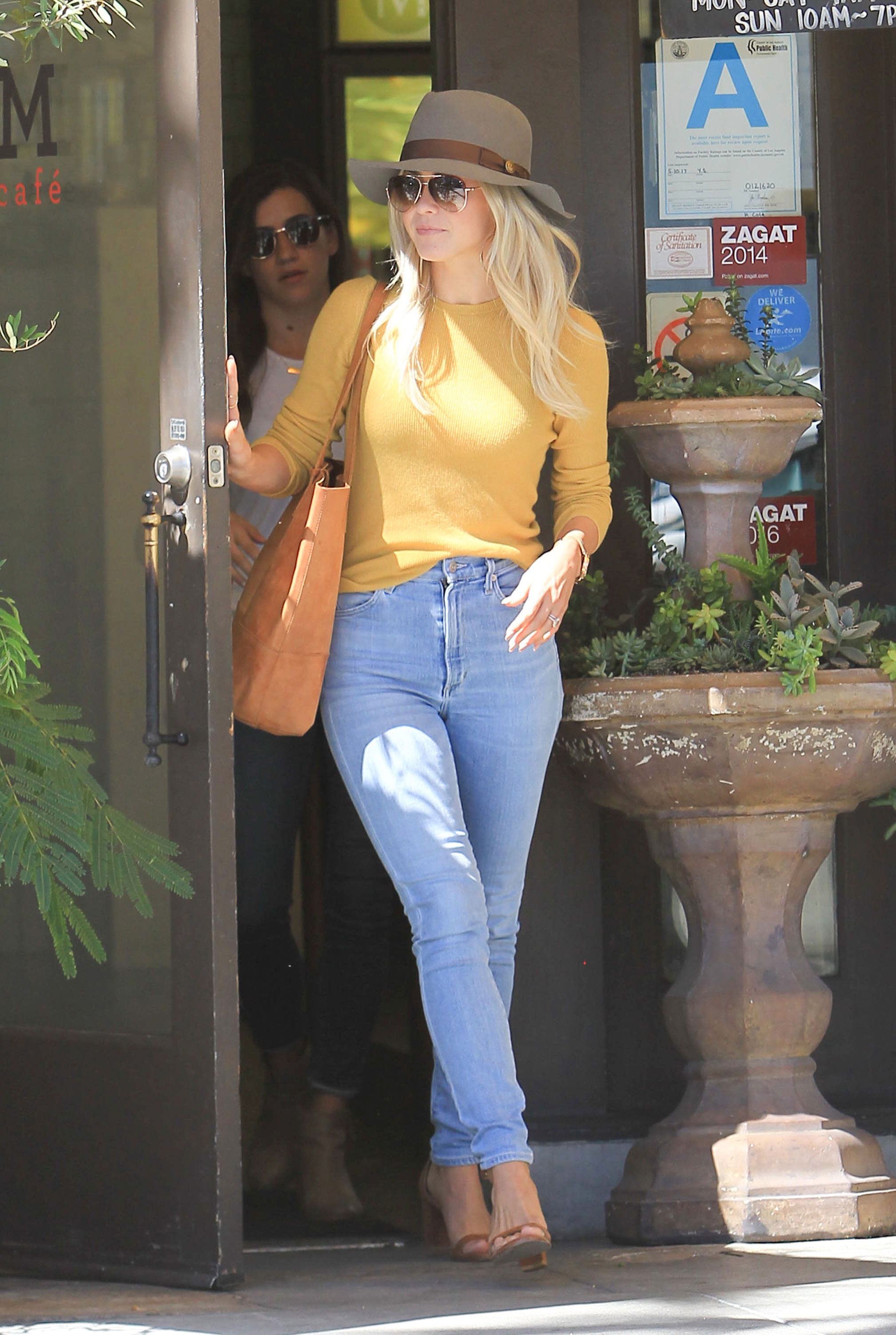 Try a yellow sweater with your favorite jeans for a casual fall outfit.