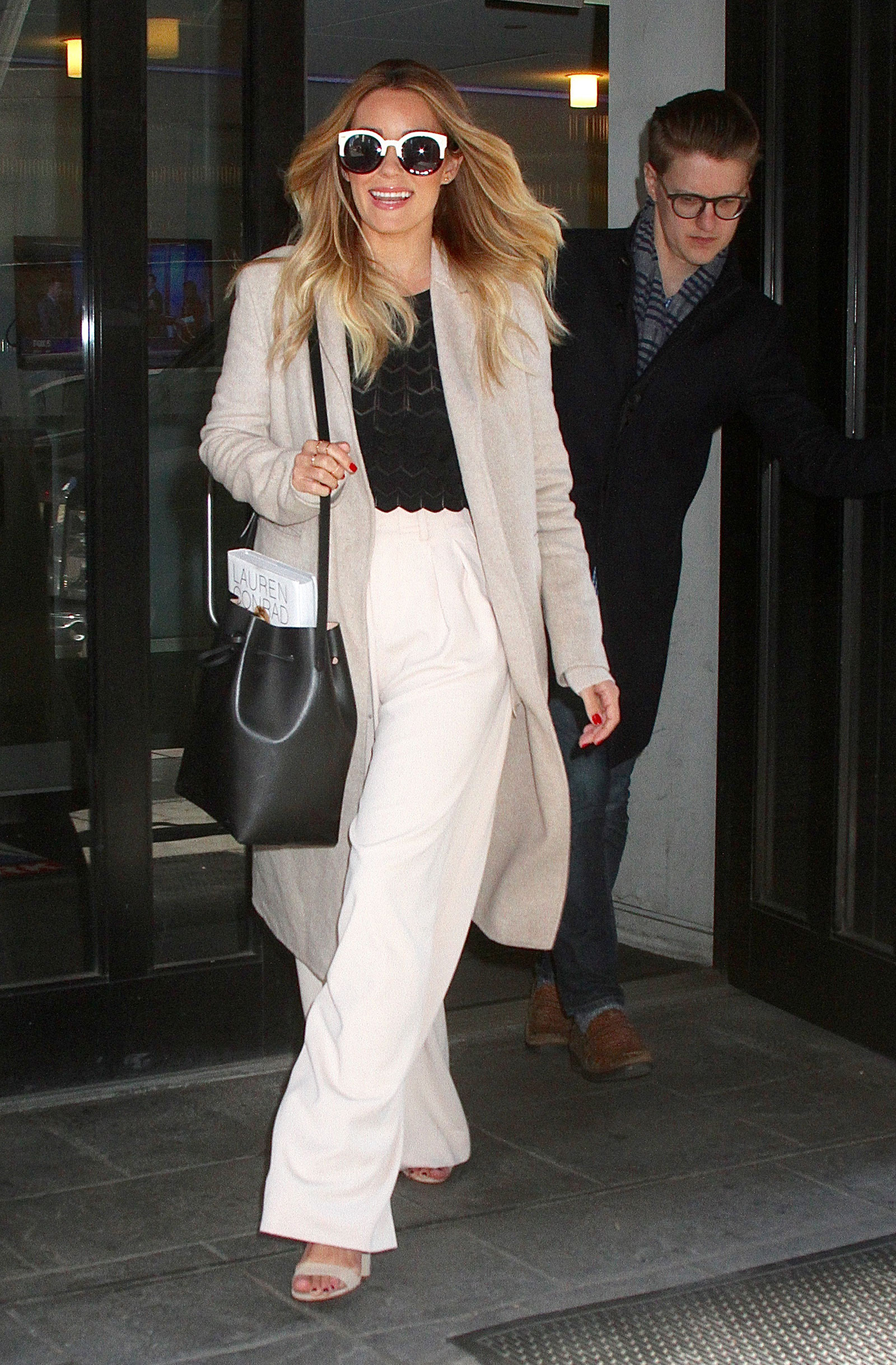 Get Lauren Conrad's chic white wide leg pants and black scalloped top look for yourself with these budget-friendly finds.