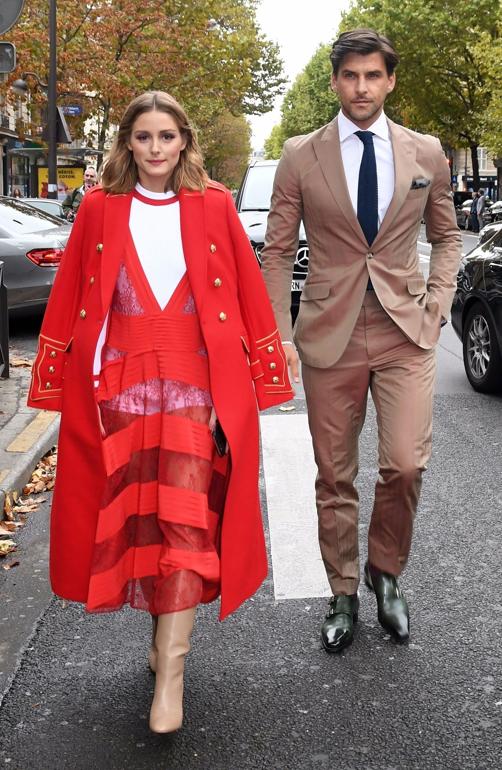 Olivia Palermo and husband Johannes Huebl are seen arriving at the Valentino fashion show in Paris during fashion week.