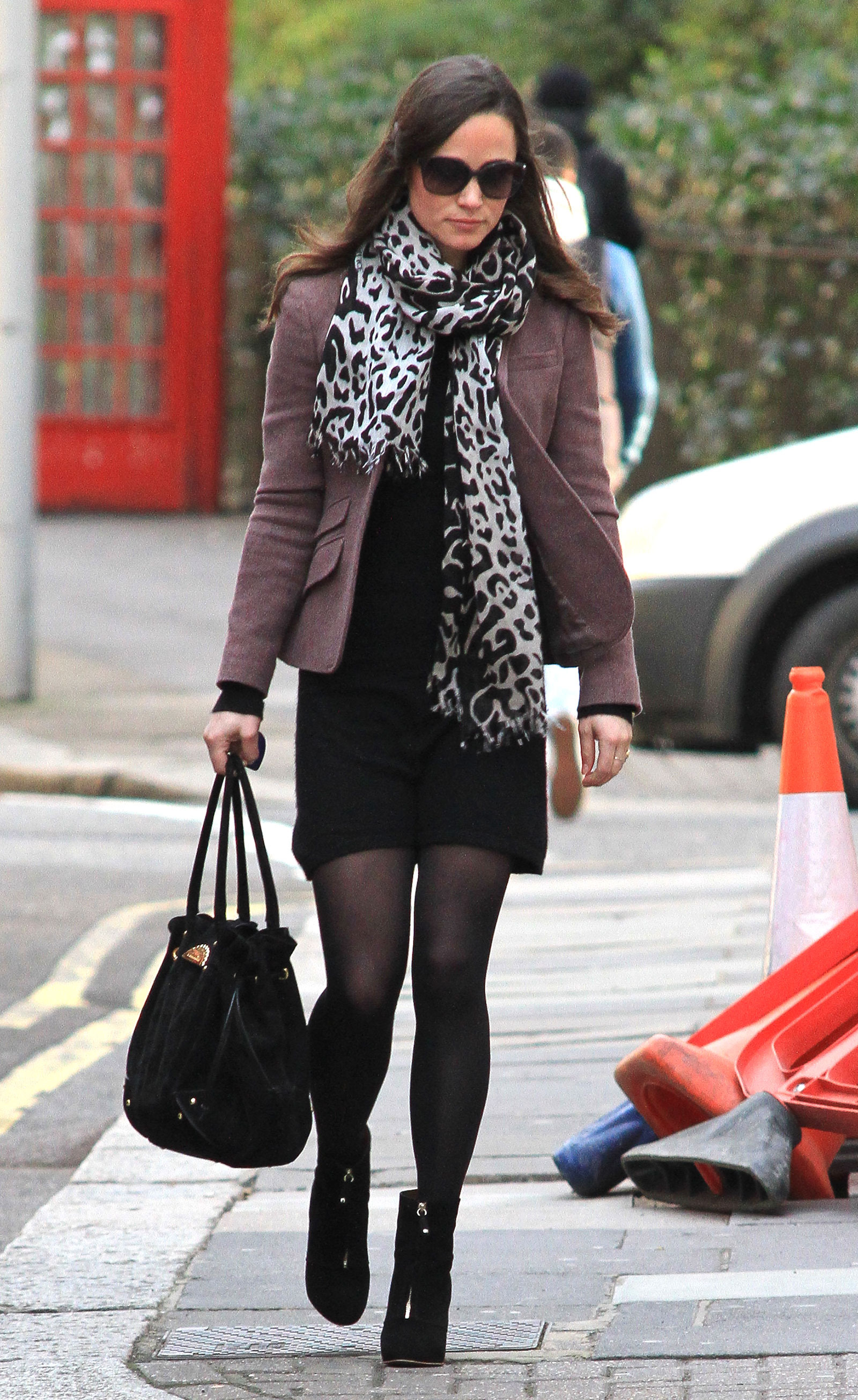 Pippa Middleton looks stylish in a leopard scarf, brown blazer and black dress.