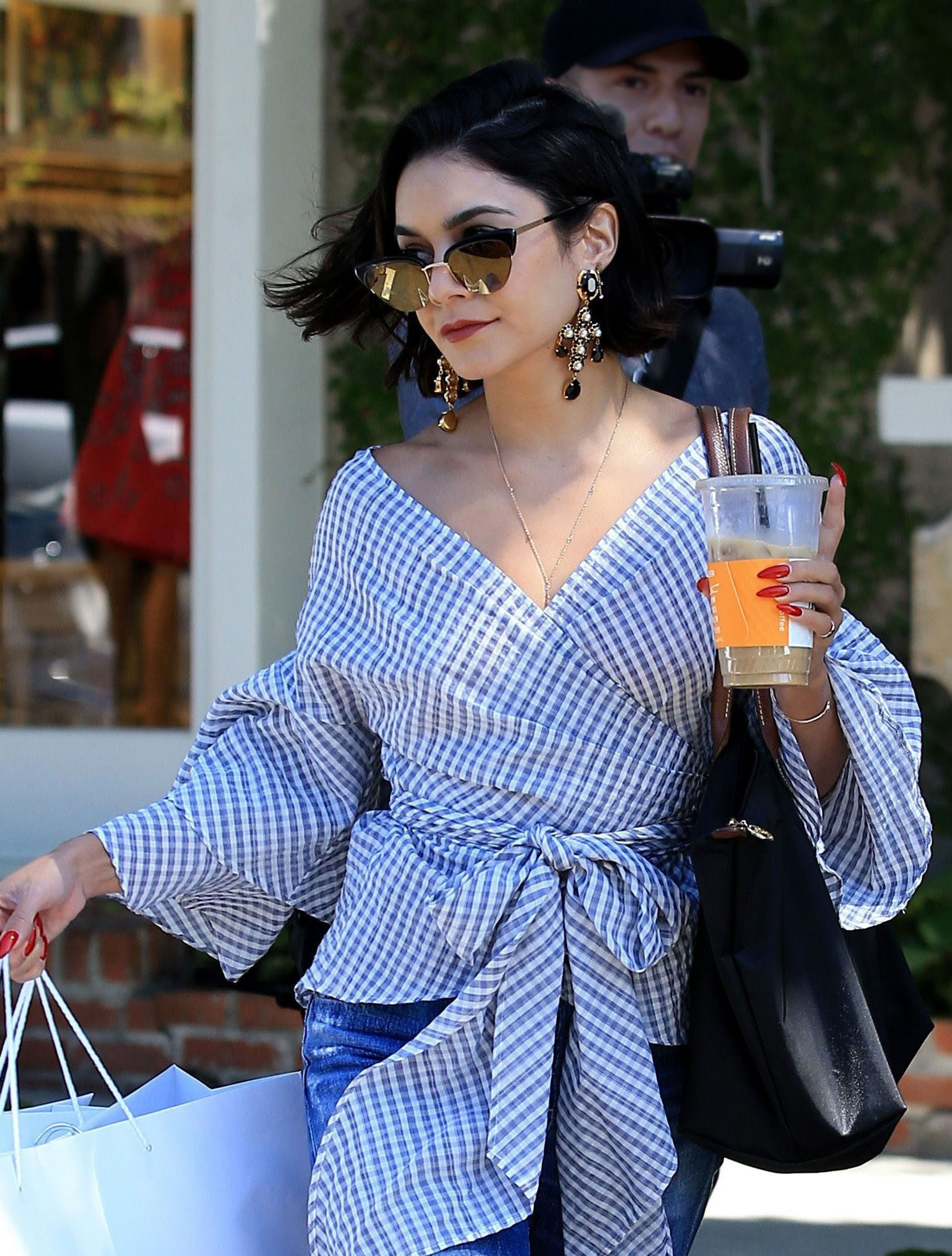 Vanessa Hudgens wears a Wayf gingham bell sleeve top under $100.