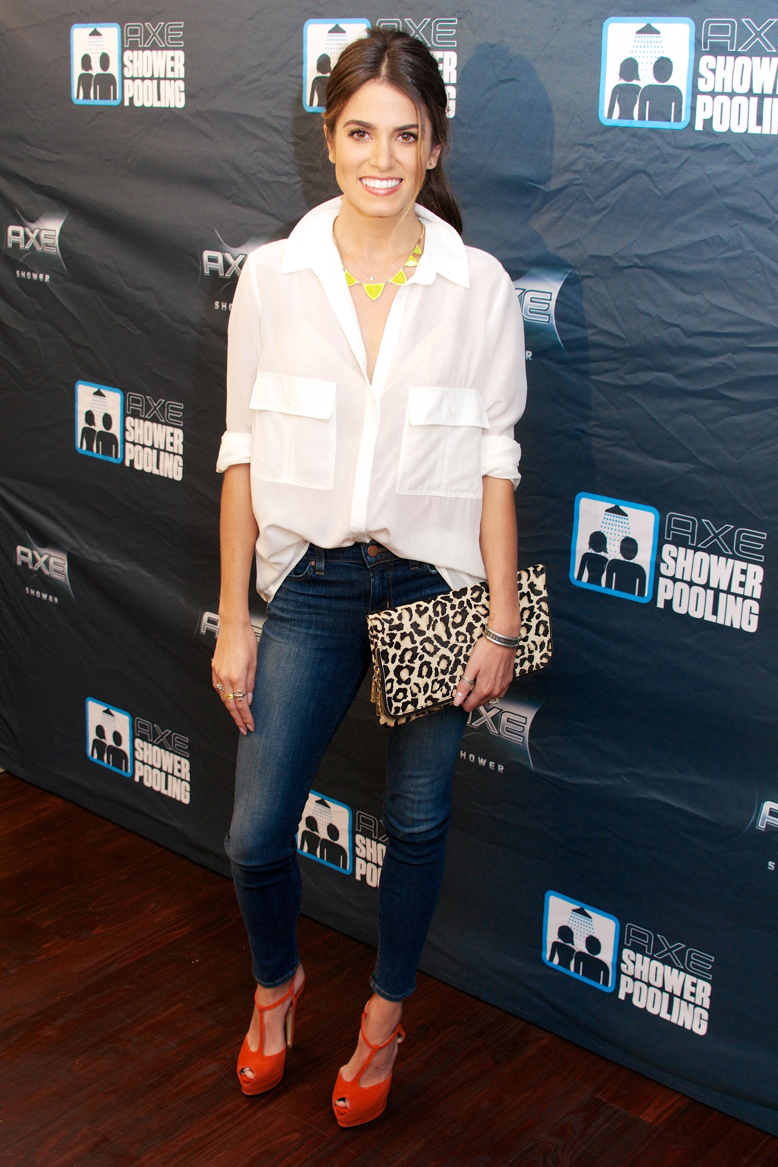 Nikki Reed celebrity look for less featuring white shirt, skinny jeans, leopard clutch, red heels
