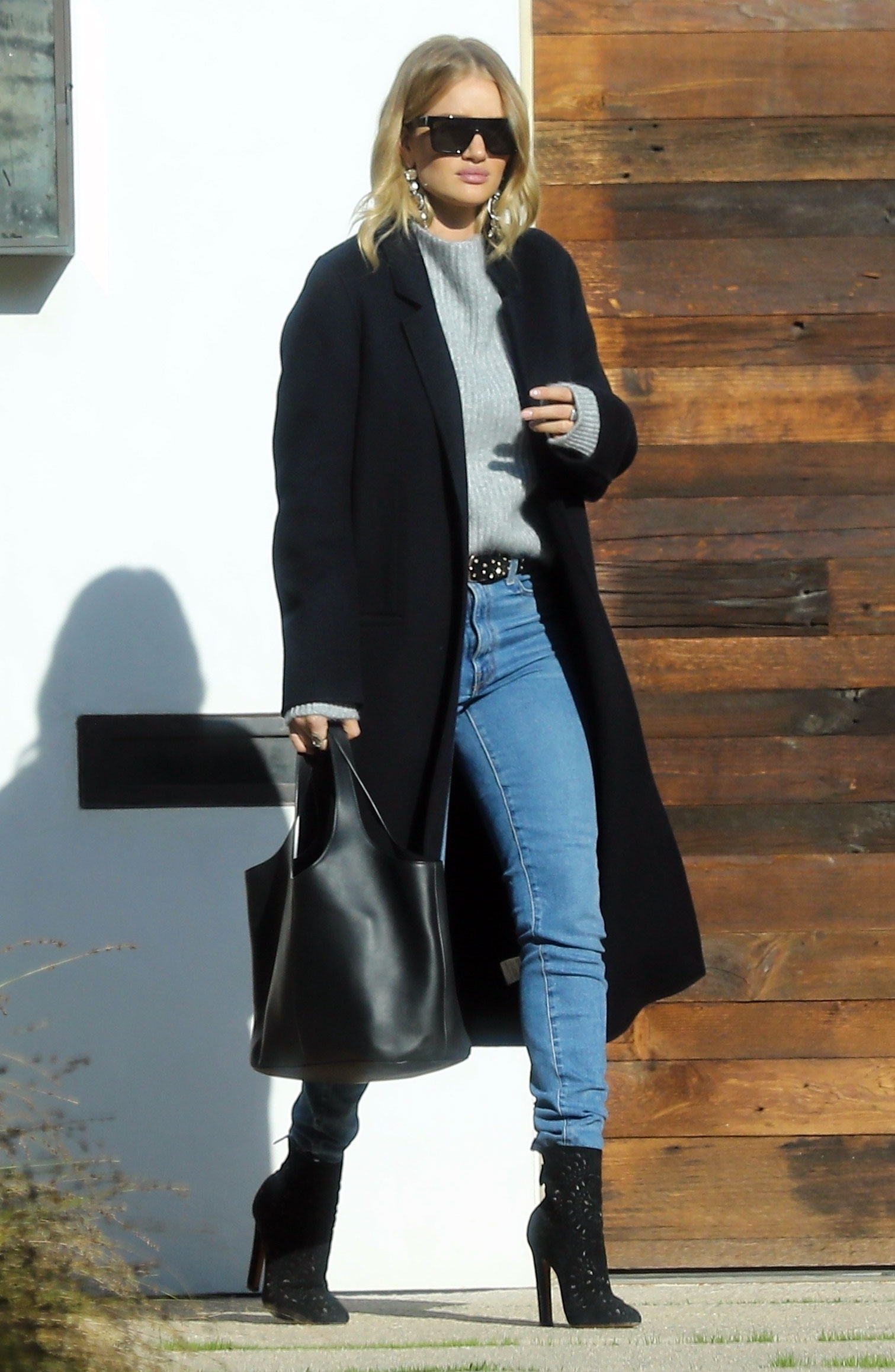 990e7cf20ef Rosie Huntington-Whiteley s Black Wool Coat and Gray Sweater.