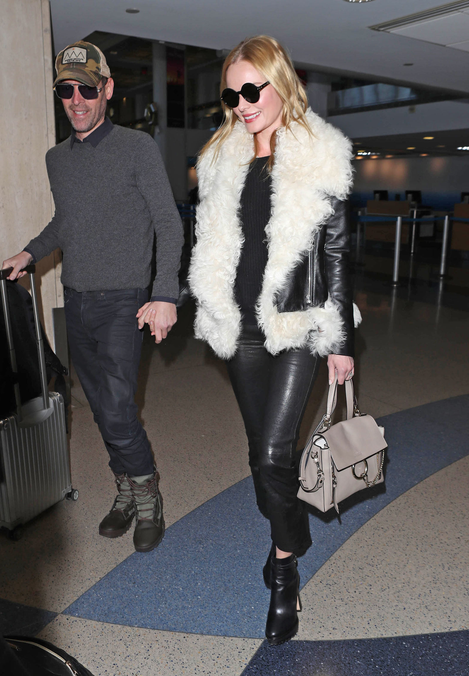 Kate Bosworth wears a shearling lined biker jacket with leather pants and Nicholas Kirkwood ankle boots.