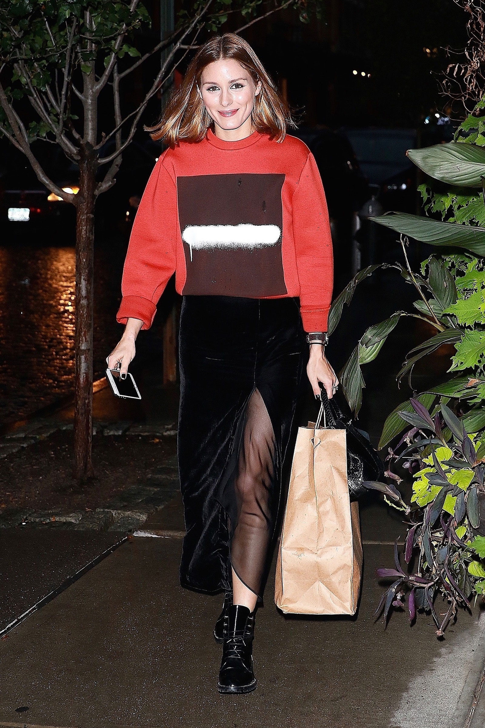 For an unconventional holiday party look, try a velvet midi skirt, chunky red sweater and combat boots like Olivia Palermo.