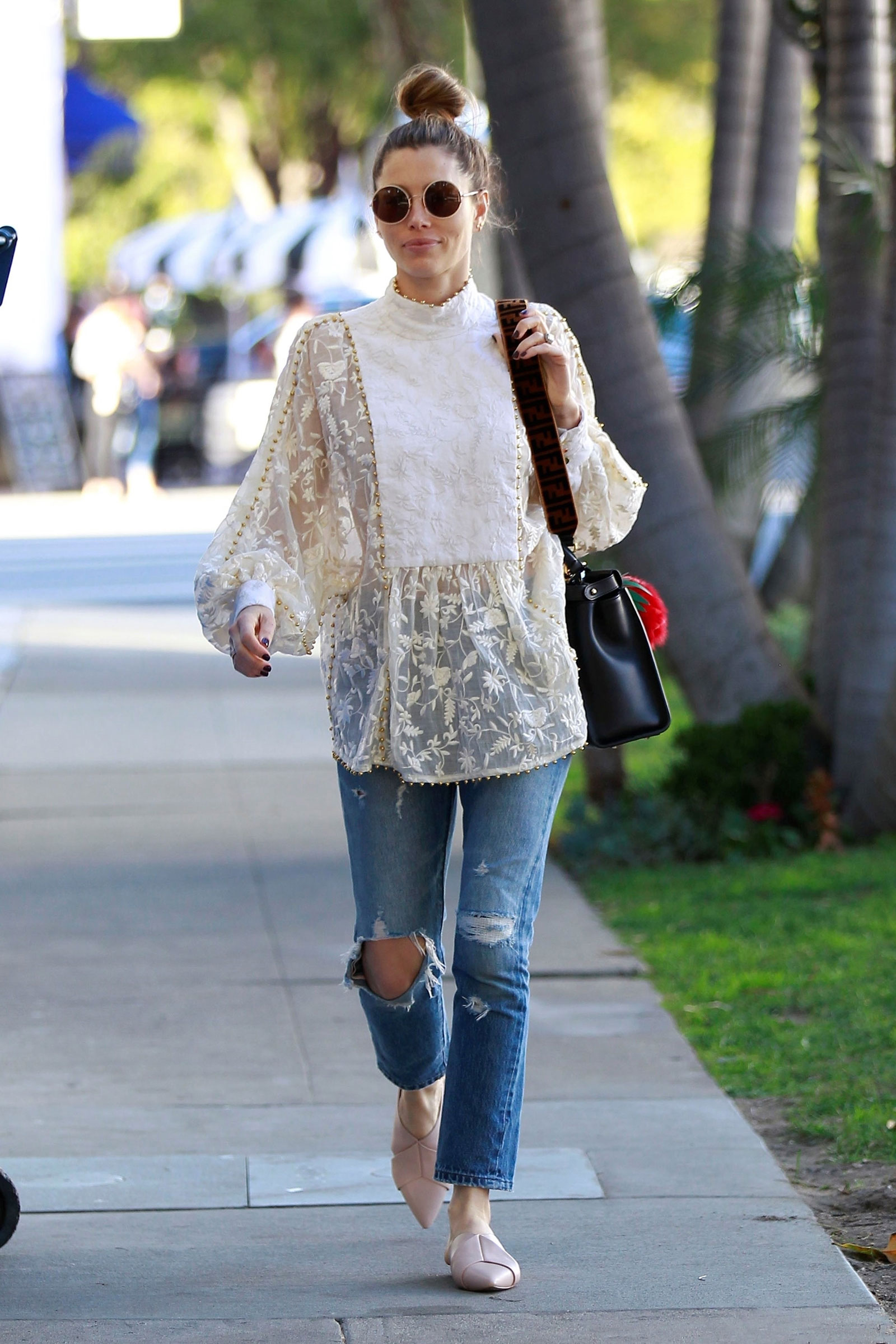 Jessica Biel's lace blouse and pointy mules look for less