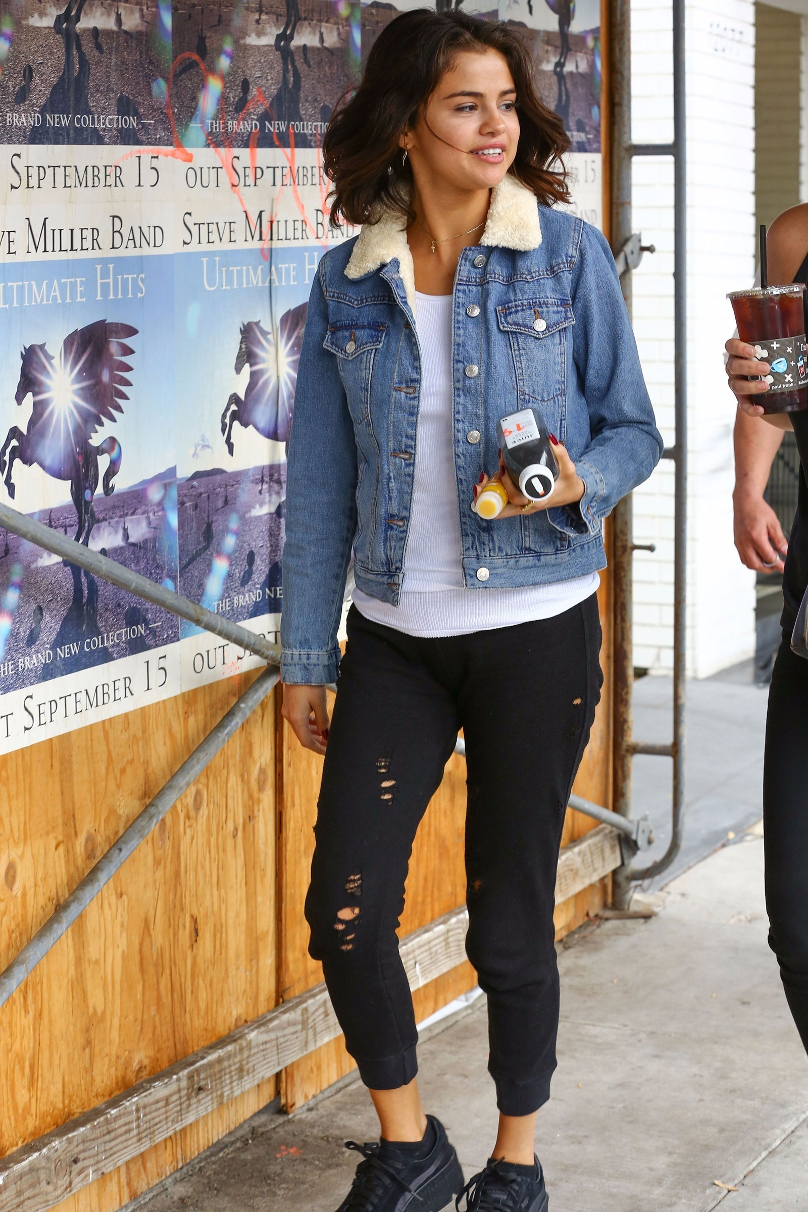 9a625b06577174 Selena Gomez s Sherpa Denim Jacket and Distressed Joggers Look for ...