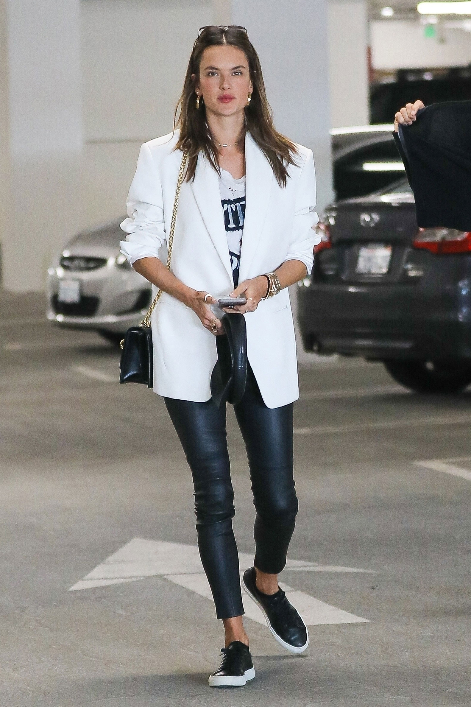 Alessandra Ambrosio's white blazer, graphic tee, liquid leggings and leather sneakers look for less