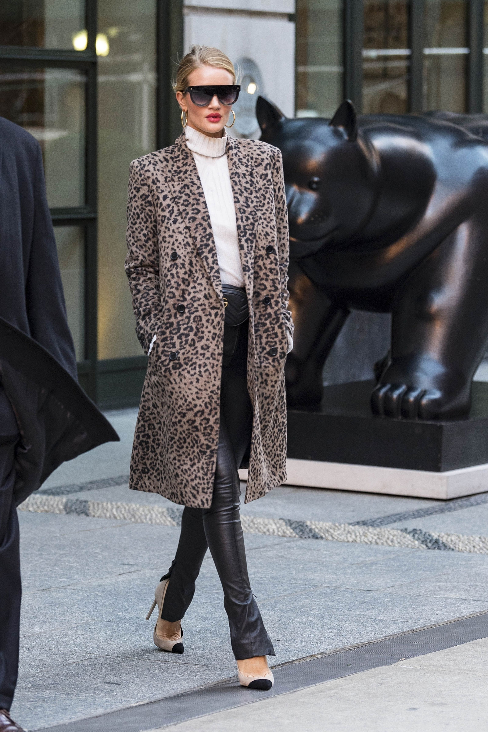 Rosie Huntington-Whiteley wears a leopard coat with leather pants and cap-toe pumps