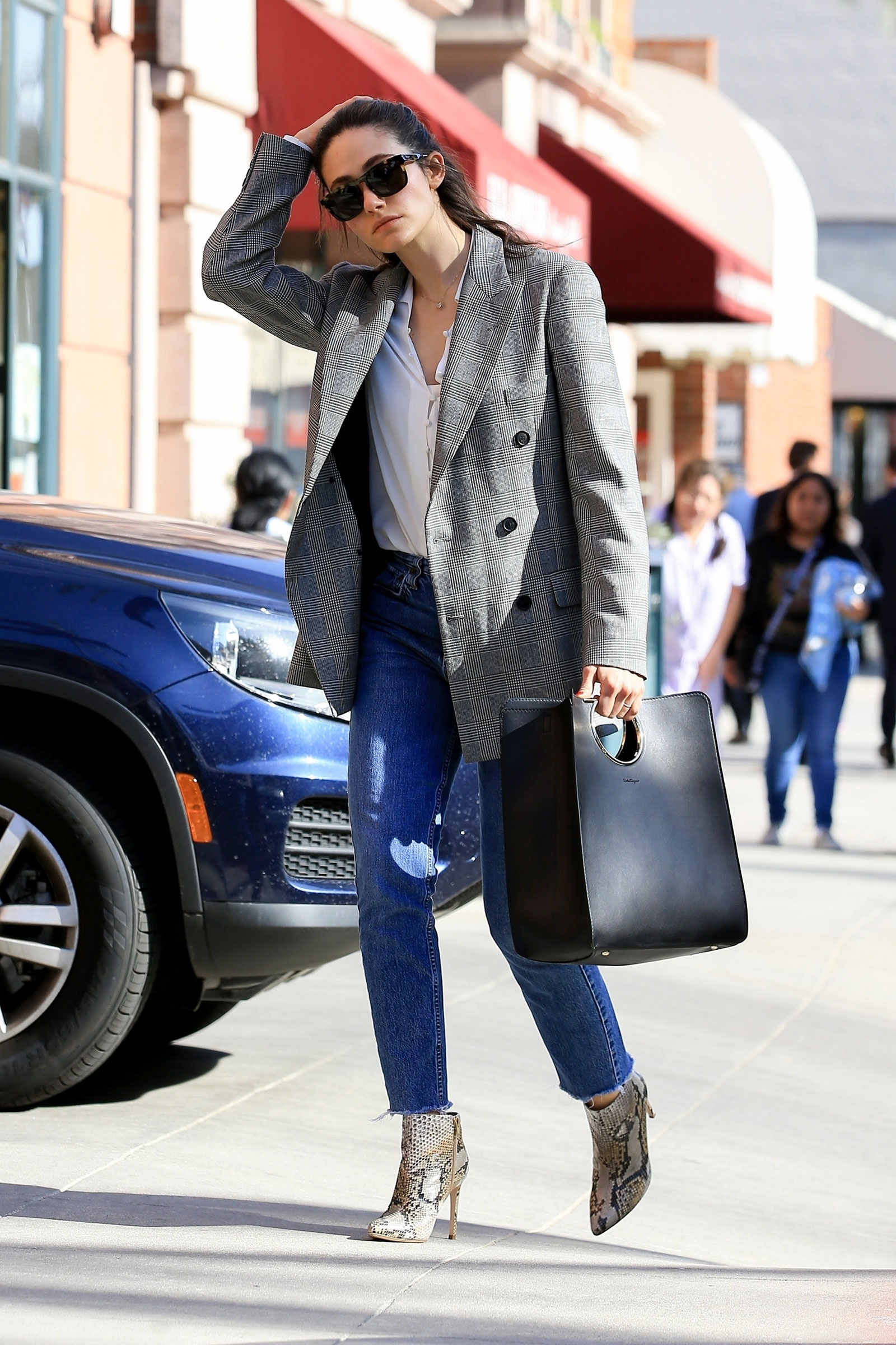 Emmy Rossum's blazer and python boots look for less