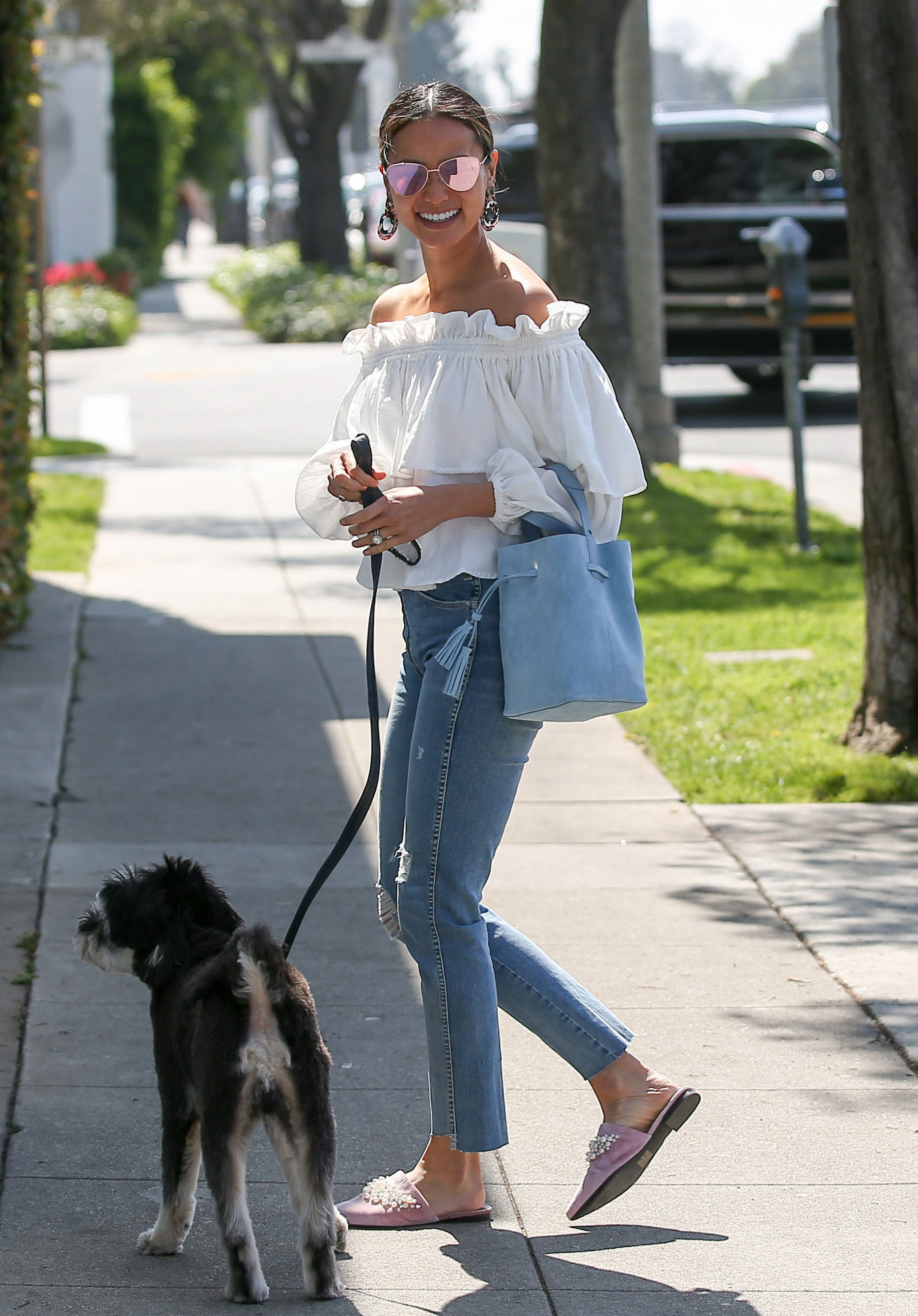 Jamie Chung's off the shoulder top and pink mule slides.