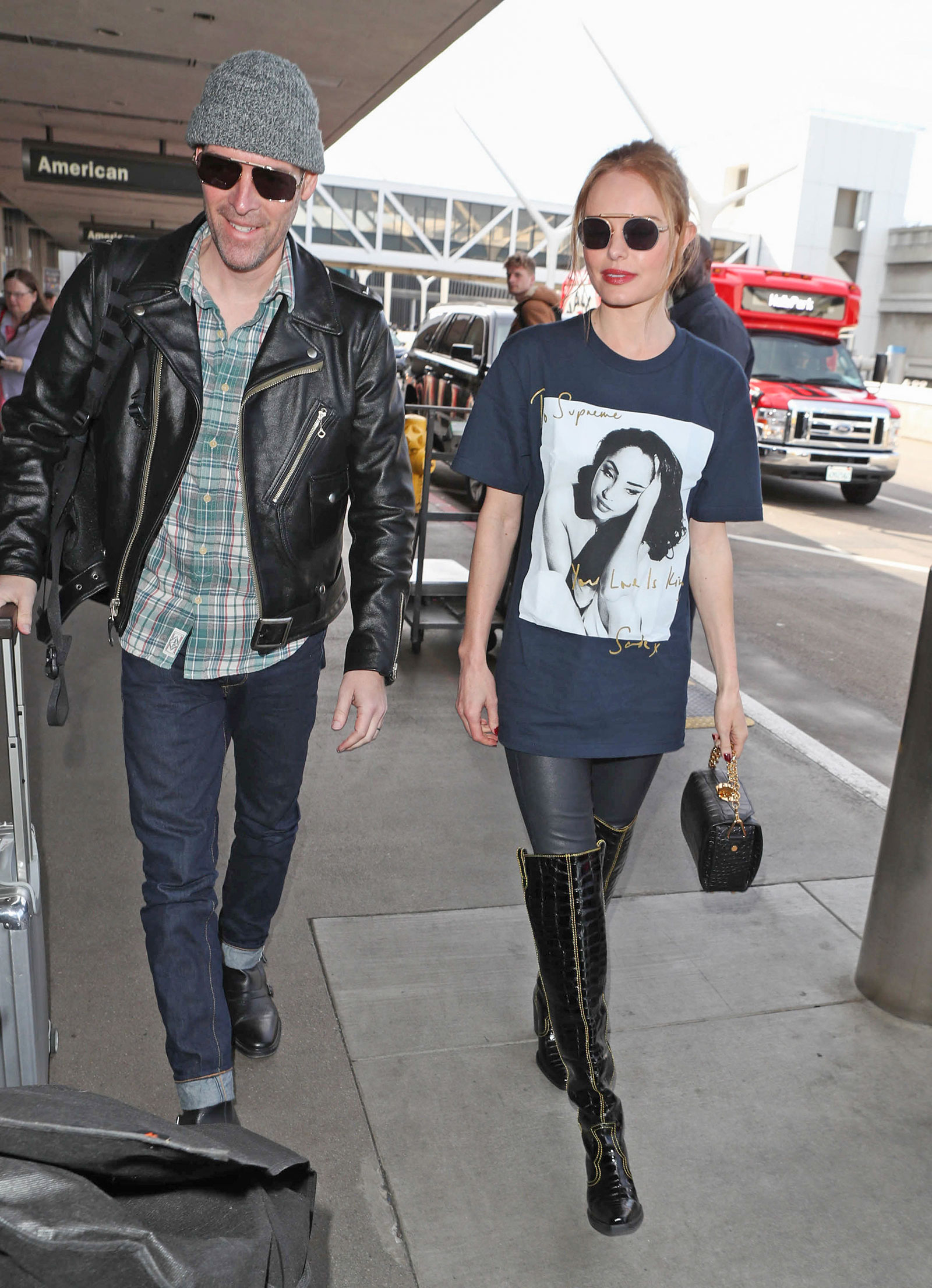 Kate Bosworth wears a Sade t-shirt by Supreme while making her way through LAX.